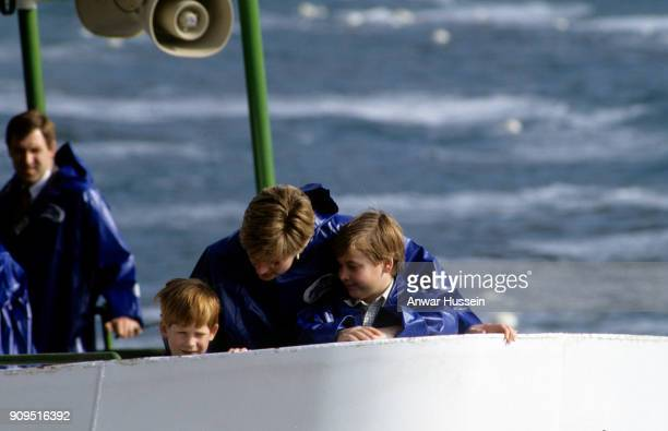 Diana Princess of Wales Prince William and Prince Harry wear waterproof capes as they take a trip in a boat during a visit to the Niagara Falls on...