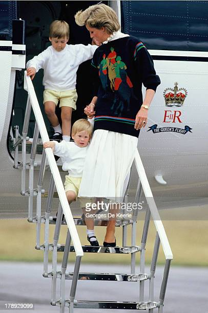 Diana Princess of Wales and her young sons Prince William and Prince Harry arrive at Aberdeen Airport for the start of their holidays in Scotland on...