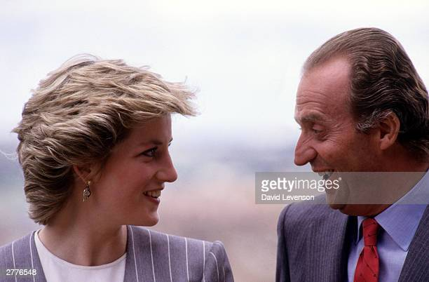 Diana Princess of Wales and King Juan Carlos of Spain talking during a visit on April 23 1987 to Toledo Spain Diana wore an outfit designed by...
