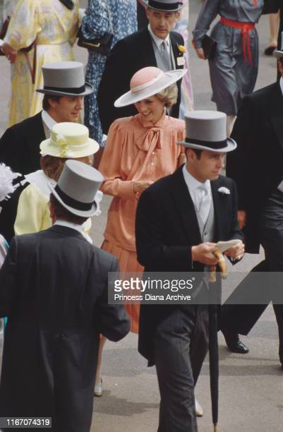 Diana Princess of Wales and Prince Andrew at Ascot racecourse in England June 1985 She is wearing a suit by Jan Van Velden and a hat by Frederick Fox