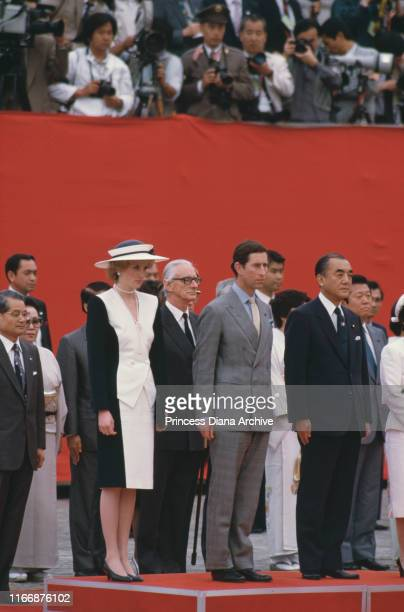 Diana Princess of Wales and Prince Charles are officially welcomed to the Akasaka Palace in Tokyo by Japanese Prime Minister Yasuhiro Nakasone May...