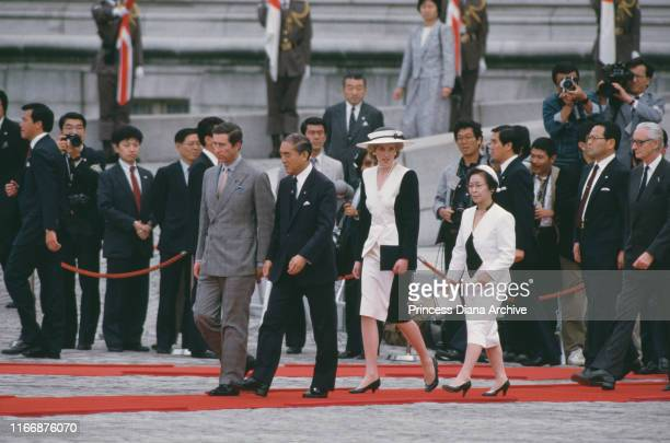 Diana, Princess of Wales and Prince Charles are welcomed to the Akasaka Palace in Tokyo by Japanese Prime Minister Yasuhiro Nakasone and his wife...
