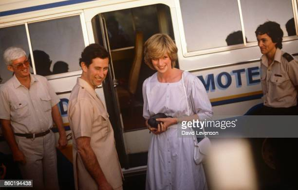 Diana Princess of Wales and Prince Charles arrive by minibus at Ayer's Rock on March 21 1983 near Alice Springs Australia during the Royal Tour of...