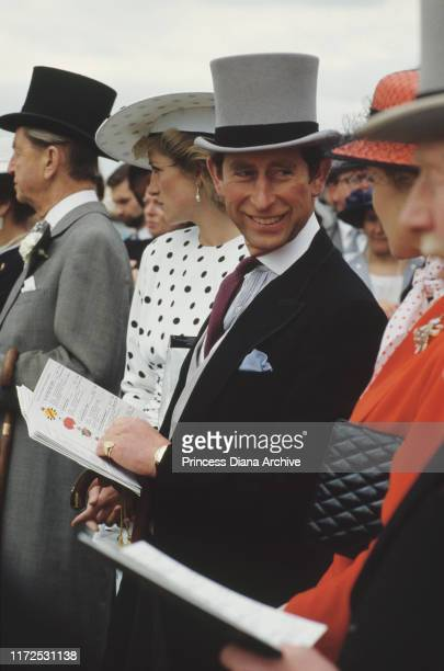 Diana, Princess of Wales and Prince Charles at the Epsom Derby, UK, June 1986. Diana is wearing a black and white spotted dress by Victor Edelstein.