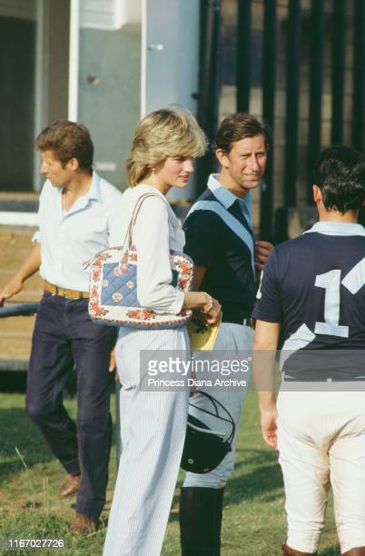 Diana, Princess of Wales and Prince Charles attend a polo match at Cowdray Park Polo Club in West Sussex on their second wedding anniversary, 29th...