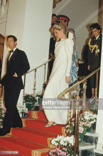 Diana, Princess of Wales and Prince Charles attend a state dinner held by the Emir of Bahrain at Al-Qudaibiya Palace in Manama, Bahrain, November...