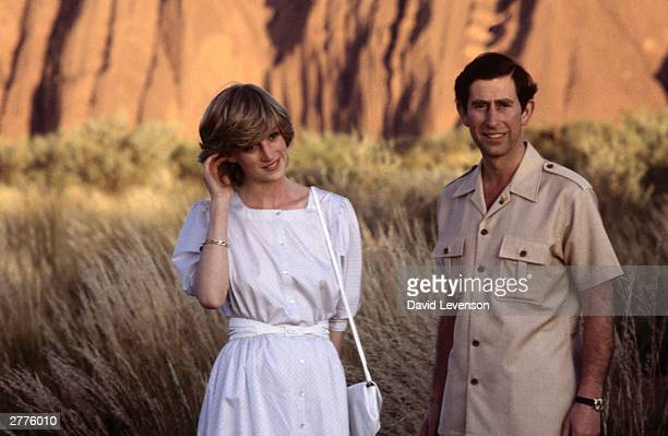 Diana Princess of Wales and Prince Charles pose in front of Ayer's Rock on March 21 1983 near Alice Springs Australia during the Royal Tour of...