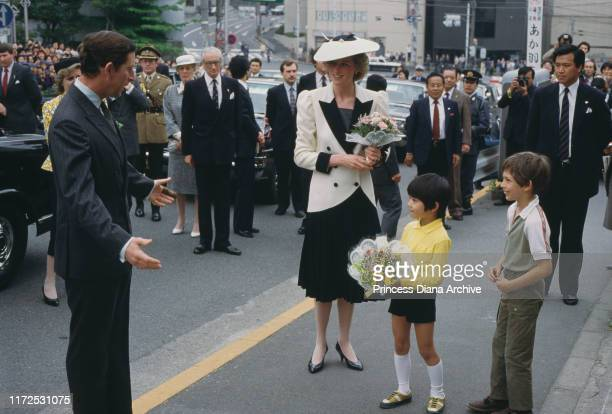 Diana, Princess of Wales and Prince Charles outside the Mitsukoshi department store in Tokyo, Japan, May 1986.