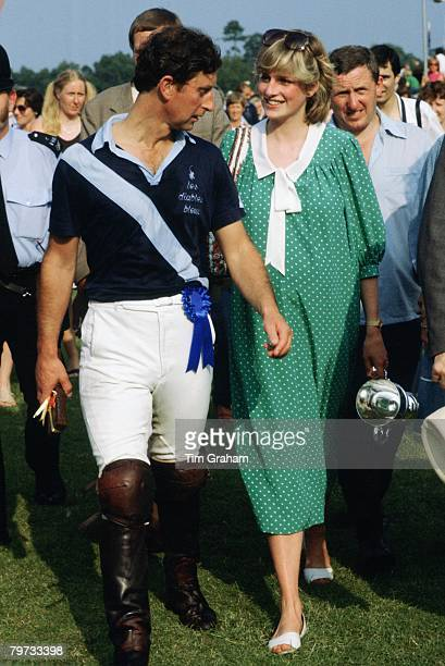 Diana, Princess of Wales and Prince Charles, Prince of Wales at Polo in Windsor, Diana is pregnant and is wearing a dress designed by Catherine Walker