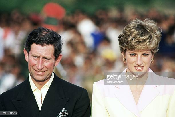 Diana Princess of Wales and Prince Charles Prince of Wales watch a polo match in Jaipur during a tour of India