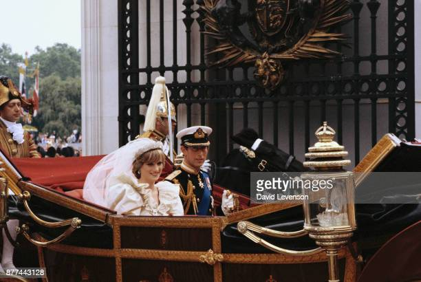 Diana Princess of Wales and Prince Charles ride in a carriage after their wedding at St Paul's Cathedral July 29 1981 in London