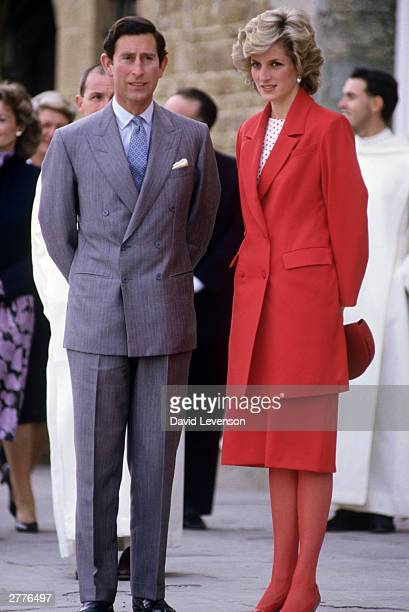 Diana Princess of Wales and Prince Charles visit a church on April 23 1985 in Florence Italy during the Royal Tour of Italy Diana wore a suit by...