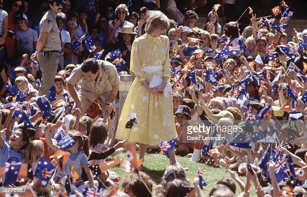 Diana Princess of Wales and Prince Charles visit Alice Spring School of the Air on March 21 1983 in Alice Springs Australia Diana wore a dress by Jan...