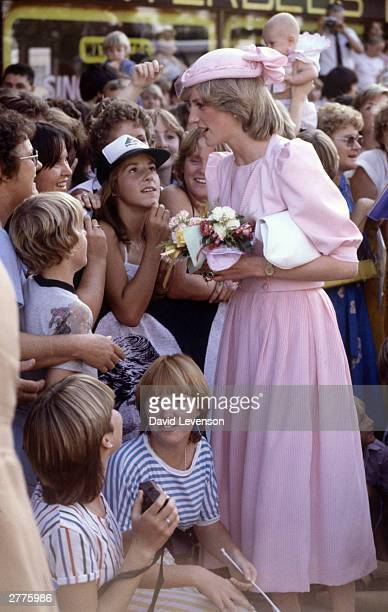 Diana Princess of Wales and Prince Charles visit Maitland Australia on March 29 1983 during the Royal Tour of Australia Diana wore a dress by...