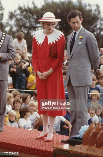 Diana Princess of Wales and Prince Charles visit the Memorial Oval at Port Pirie in Australia 6th April 1983 She is wearing a Jan Van Velden suit and...