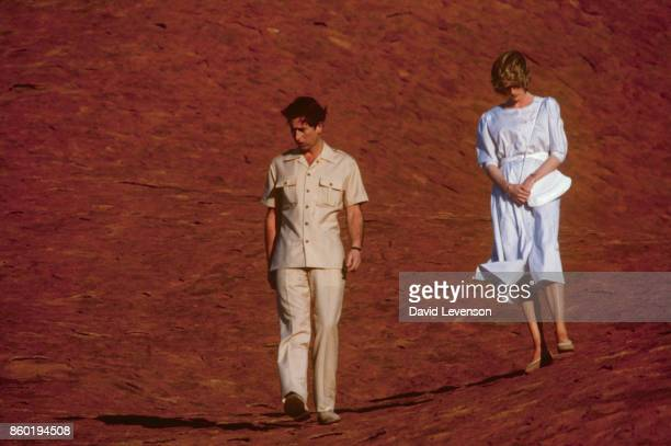 Diana Princess of Wales and Prince Charles walk down Ayer's Rock on March 21, 1983 near Alice Springs, Australia during the Royal Tour of Australia....