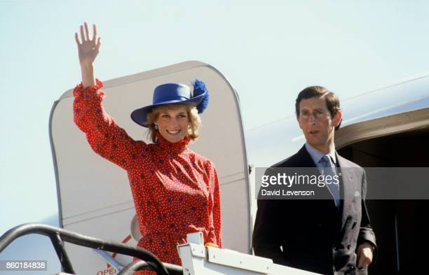Diana Princess of Wales and Prince Charles wave goodbye as they leave Melbourne Airport on April 17 1983 in Melbourne Australia at the end of their...