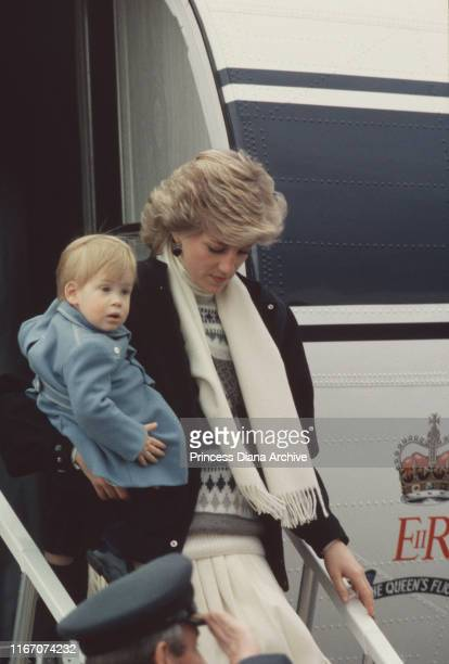 Diana Princess of Wales and Prince Harry arrive at Aberdeen airport in Scotland on The Queen's Flight March 1986