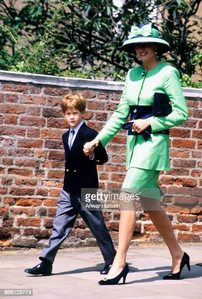 Diana Princess of Wales and Prince Harry walk to St George's Chapel to attend the wedding of Lady Helen Windsor to Tim Taylor on July 18 1992 in...