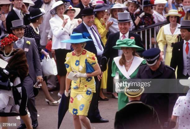 Diana Princess of Wales and Sarah Duchess of York stroll through the Royal Enclosure at Royal Ascot races at Ascot racecourse Ascot Berkshire in June...