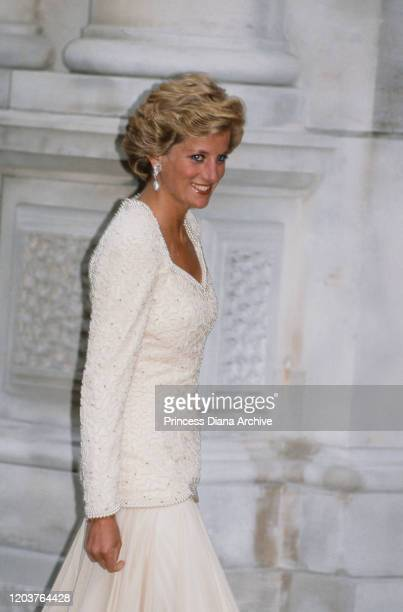 Diana Princess of Wales arrives at a party held for the former King Constantine of Greece in London June 1989 She is wearing a white beaded dress by...