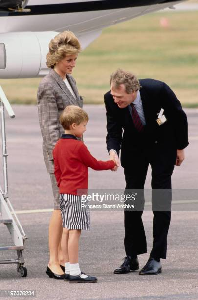 Diana, Princess of Wales arrives at Aberdeen airport in Scotland on the Royal Flight, with her son Prince William, 14th August 1989. They are...