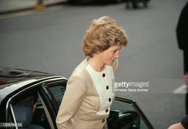 Diana, Princess of Wales arrives at Claridge's Hotel in London for a charity lunch, April 1989. She is wearing a suit by Catherine Walker.