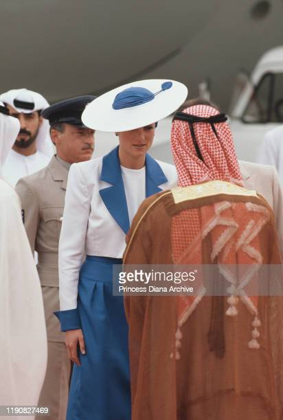 Diana, Princess of Wales arrives at Dubai airport in the United Arab Emirates, March 1989. She is wearing a blue and white suit by Catherine Walker...