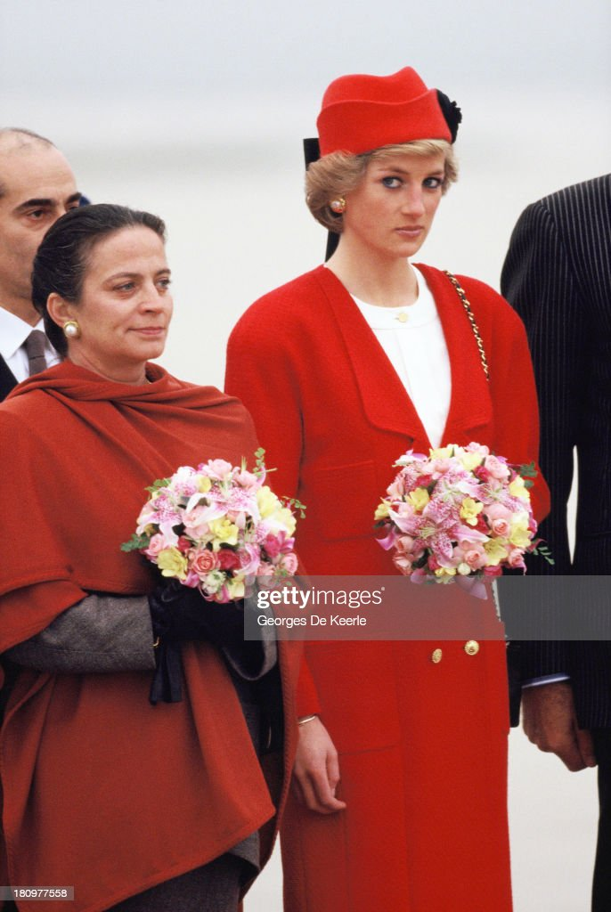 Diana (R), Princess of Wales, arrives at the Orly airport during her official visit to France on November 7, 1988 in Paris, France. The princess wears a Chanel coat.