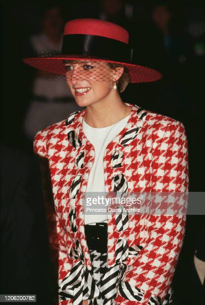 Diana, Princess of Wales arrives at Toronto airport for an official visit to Canada, 23rd October 1991. She is wearing a red, white and black...