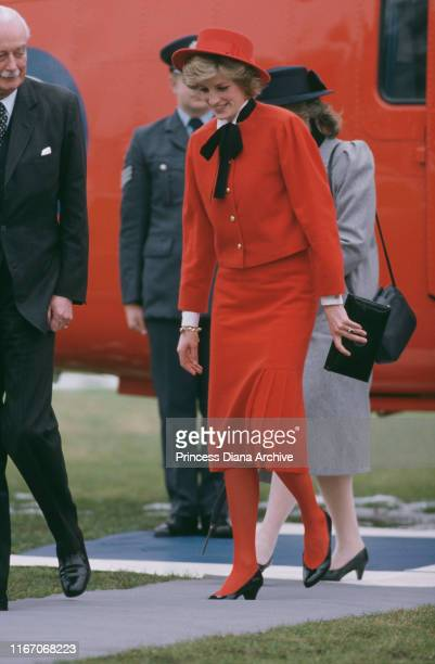 Diana Princess of Wales arrives in Cirencester UK by royal helicopter February 1985 She is wearing a red suit and matching John Boyd hat