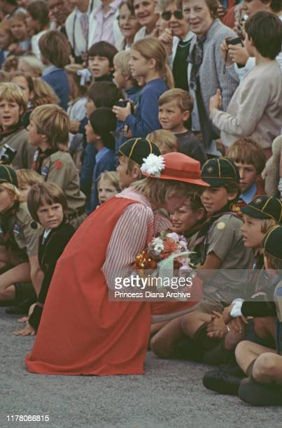 Diana Princess of Wales arrives in Hobart Tasmania wearing a red Bellville Sassoon suit and a hat by John Boyd March 1983