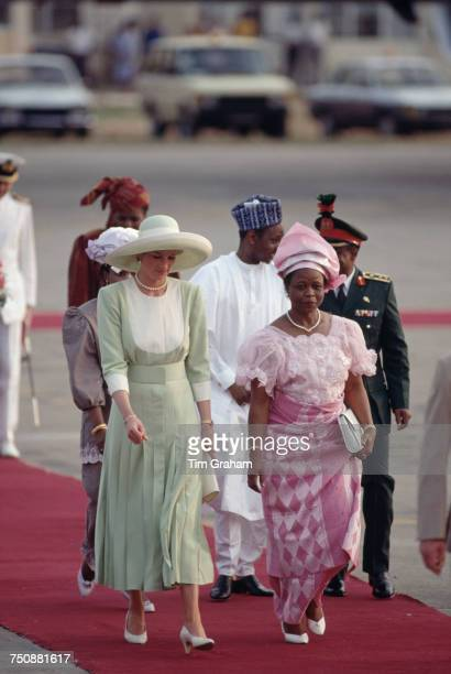 Diana Princess of Wales arrives in Lagos Nigeria for an official visit 15th March 1990 With her is Nigerian First Lady Maryam Babangida The princess...