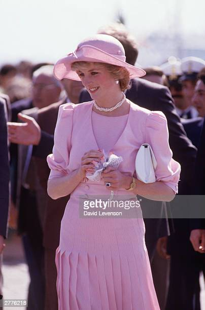Diana Princess of Wales arrives in Sicily on April 30 1985 during the Royal Tour of Italy Diana wore a dress designed by Catherine Walker and a hat...