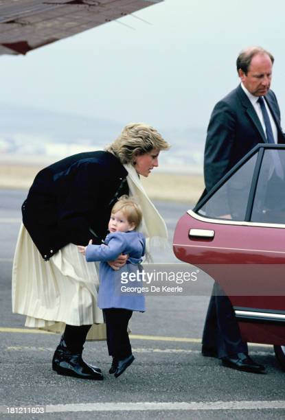 Diana Princess of Wales arrives with her son Prince Harry at Aberdeen Airport on March 14 1986 in Aberdeen Scotland