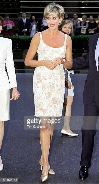 Diana Princess Of Wales Arriving At Christie's In New York For The Preauction Party Wearing A Champagnecoloured Cocktail Dress Embroidered With...