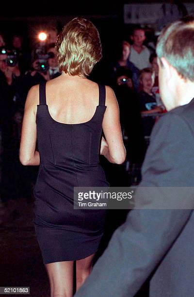 Diana Princess Of Wales As She Walks Towards The Cameras With Her Bodyguard Dave Sharp On Leaving The Film Preview Of 'apollo 13' In London