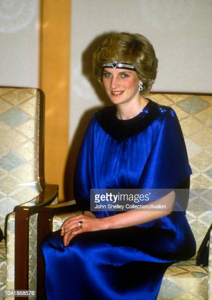 Diana, Princess Of Wales, at a dinner hosted By Emperor Hirohito in Japan, She is wearing a pleated royal blue evening dress designed by fashion...