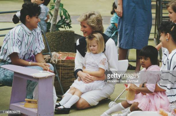 Diana, Princess of Wales at a Dr Barnardo's Home in Auburn, New South Wales, Australia, January 1988. She is wearing a dress by Catherine Walker.
