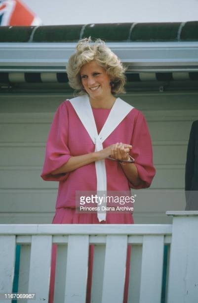 Diana, Princess of Wales at a polo match at Smith's Lawn, Guards Polo Club, Windsor, July 1984. She is pregnant with Prince Harry, and wearing a pink...