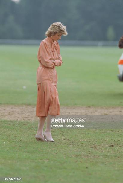 Diana Princess of Wales at a polo match on Smith's Lawn at the Guards Polo Club in Windsor UK June 1985 She is wearing a peachcoloured suit by Jan...