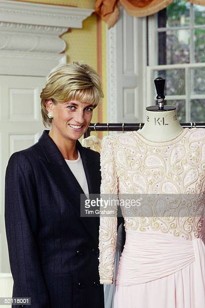 Diana Princess Of Wales At Home In Kensington Palace Standing Next To A Dress Designed By Fashion Designer Catherine Walker