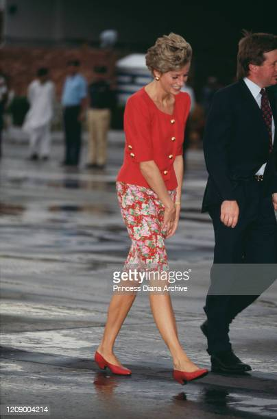 Diana, Princess of Wales at Lahore airport in Pakistan with her bodyguard Ken Wharfe , September 1991.