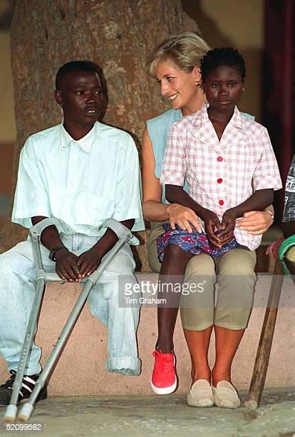 Diana Princess Of Wales At Neves Bendinha An Icrc Orthopaedic Workshop In Luanda Angola With 13 Year Old Sandra Thijika On Her Knee Who Lost Her Leg...
