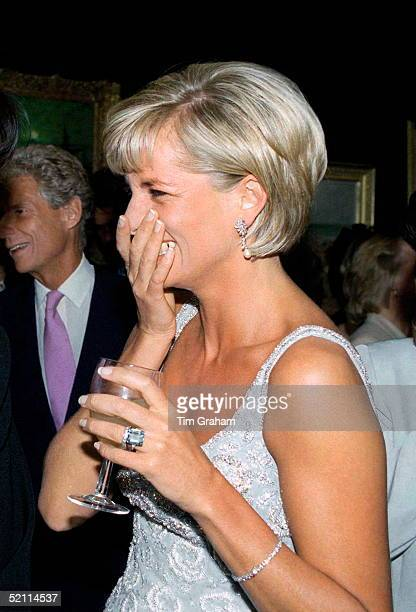 Diana Princess Of Wales At The Christie's Preauction Party For The Launch Of The Auction Of Dresses She Is Wearing A Dress By Fashion Designer...