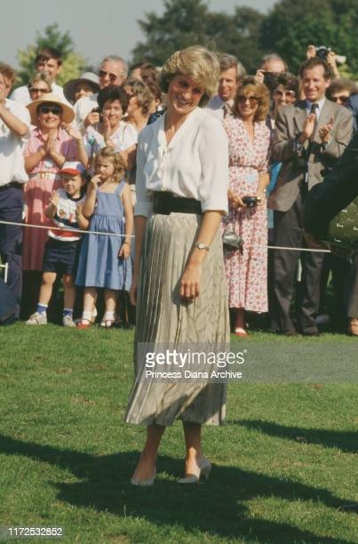 Diana Princess of Wales at the Harrods Polo Cup on Smith's Lawn Guards Polo Club Windsor UK 11th July 1987 She is presenting the prizes with Mohamed...