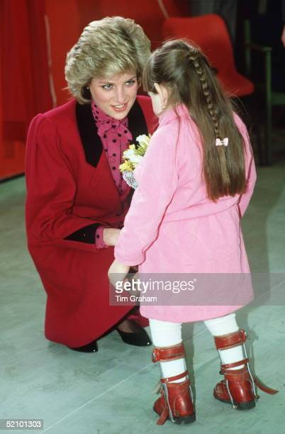 Diana, Princess Of Wales, At The Markfield Project In London Talking To A Young Girl Wearing Leg Braces.