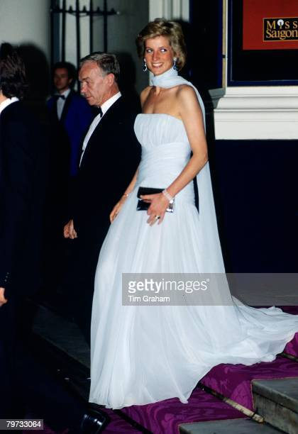 Diana Princess of Wales at the Theatre Royal Drury Lane for a performance of the musical 'Miss Saigon' Princess Diana is wearing a chiffon dress...