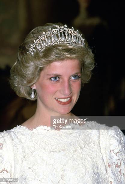 Diana Princess of Wales attending a dinner at the British Embassy The Princess is wearing a taffeta and lace gown with a scalloped neckline designed...