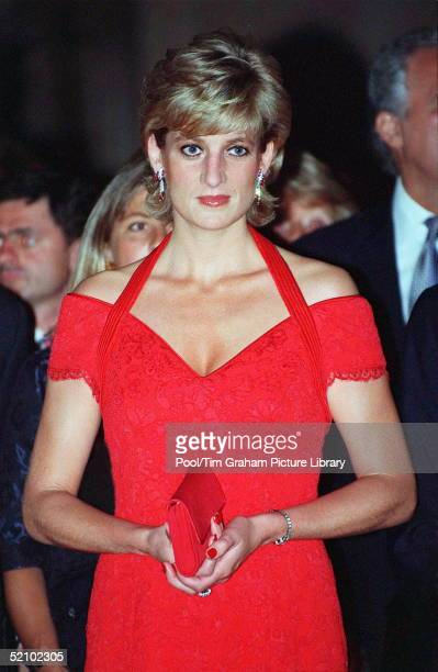 Diana Princess Of Wales Attending A Dinner Hosted By Alpi [ Association For The Struggle Against Infant Paralysis] She Is Wearing A Red Lace Evening...